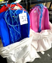 A group of twelve blue, red and pink moulded plastic sledges, with blue rope pulls.