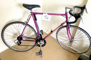 A vintage Peugeot Course pink painted gent's racing bike.