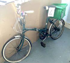 A vintage Dawes green painted lady's shopper bike.
