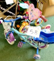 Two children's bikes, both with pale blue painted frames and stabilisers, together with a pink '