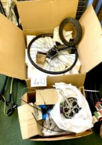 Two cardboard boxes containing a variety of bike parts, including a D.H.Disc wheel and rear gear