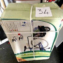 A boxed Eco Trailer Mini bike trailer.