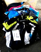 A quantity of cycling apparel, mostly men's jerseys.