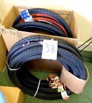 A group of bicycle tyres, including Duro and Schwalbe.