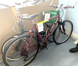 A Specialized Stumpjumper dark red painted gent's mountain bike, with front suspension.