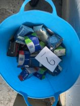 A blue plastic twin handled tub containing a quantity of boxed tyre inner tubes, including Schwalbe,