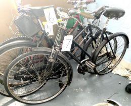 A vintage Curzon black painted lady's road bike.