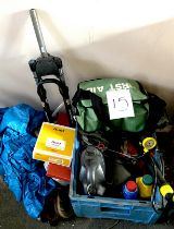 A quantity of bike tools, bottles of oils, tyre pump, first aid kit, a set of MBT front 'Rock Shox',