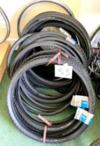 A group of bicycle tyres, including Schwalbe and Clemente.
