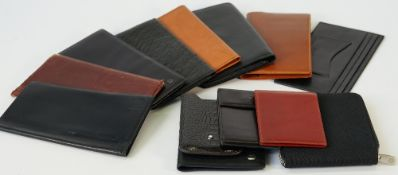 A black ostrich leather wallet by Dunhill, six further Dunhill wallets,