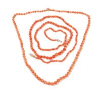 Two coral necklaces, 20th century, each formed of graduated beads, one with clasp detailed 9ct,