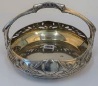 An Art Nouveau circular cake basket, detailed A.P.