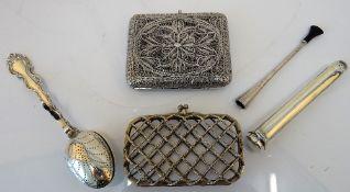 A rectangular filigree cigarette case, a rectangular lady's purse,