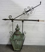 A Victorian copper street lantern, mounted on a cast iron wall bracket,