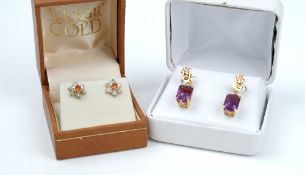 A pair of gold and amethyst single stone pendant earrings,
