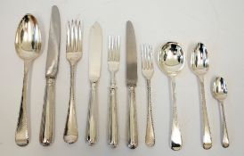 A collected George III Old English feather edge pattern silver canteen, for twelve persons,