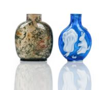 A Chinese white overlay blue glass snuff bottle, each side with a rabbit and vegetable,