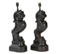 A pair of cast iron caryatid lion table lamps, 52cm high.