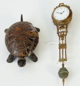 A 19th century mechanical black painted metal and tortoiseshell bell push, formed as a tortoise,