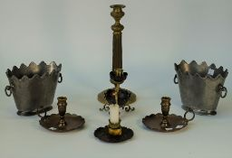 A late 19th century French ormolu and bronze chamberstick, the base formed as a leaf,
