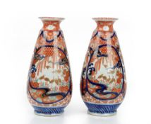 A pair of Japanese Imari vases, Meiji period, of tapered cylindrical form,