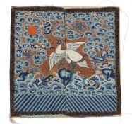 A Chinese embroidered rank badge, 19th century, depicting an egret of the sixth civil rank,