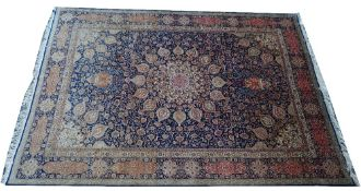 A Tabriz carpet, Persian, the dark indigo field with a large faceted central medallion,