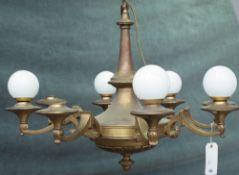 An Empire style brass eight light chandelier, 80cm wide x 62cm high.