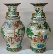 A pair of Canton famille-rose baluster vases, late 19th /20th century,