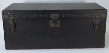 An early 20th century Louis Vuitton black leather motoring trunk, with sloping back,