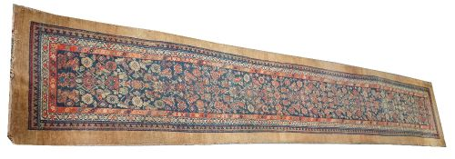 A Hamadan runner, Persian, the indigo field with a herate design, three inner borders,