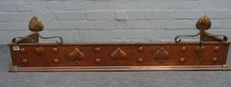 An Arts & Crafts sheet copper fire curb, 121cm wide, and an Arts & Crafts brass coal bin, 33cm high.