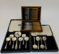 A part set of four silver small soup spoons, Sheffield 1936, weight 131 gms,