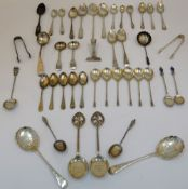 A group of silver flatware, comprising; two pairs of sugar tongs, a pair of preserve spoons,