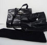 A Donna Karen New York black leather crocodile effect twin handled work bag,