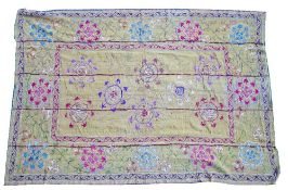 A Bokhara embroidered panel, the plain field with eight circular motifs,