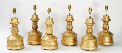A pair of giltwood table lamps, with carved decoration, 36cm high, together with four similar, (6).