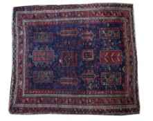 A Baluchistan rug, the indigo field with rectangular medallions,