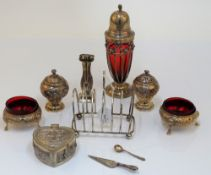 A group of silver, comprising; two similar pepperettes, London 1818 and London 1874,