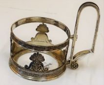 A Russian copy of a Faberge tea glass holder,