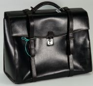 A Dunhill leather travel holdall bag, 48cm wide, and a Dunhill briefcase, 45cm wide, (2).