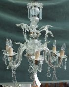 A 20th century Italian style glass six light chandelier with spiral column and moulded branches