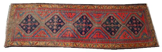 A Kazakh runner, Caucasian, the madder field with five indigo connecting medallions,