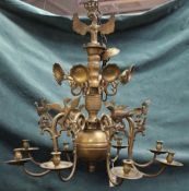 A brass eight light chandelier, the scroll branches having bird finials, in the 17th century style,