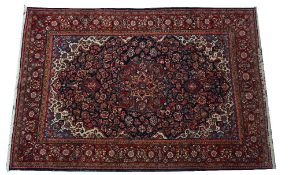 A Kashan rug, Persian, the indigo field with a madder and pink medallion,