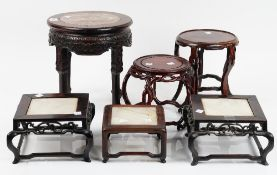 A group of six Chinese circular of square wood stands, 19th/20th century,