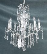 A modern silver painted metal and glass eight-light chandelier, 74cm drop x 61cm wide.