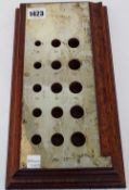 A silver mounted mahogany stand to measure the sizes of 15 differing cigars and with a 10 inch