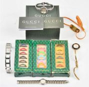 A lady's Gucci steel bangle wristwatch, with a warranty card and a booklet, with a Gucci case,