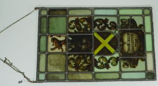 A stained glass panel, depicting a coat of arms, detailed 'THRENTE.